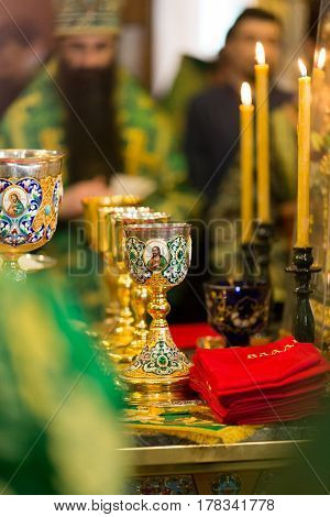 The Divine Liturgy at the Kiev Holy Presentation Monastery. Beautiful golden bowls for the Holy Communion.