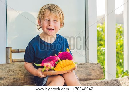 Diced Dragon Fruit And Mango In The Hands Of The Boy