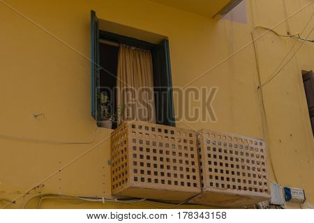Rethymno, Greece - August  5, 2016:  Old Town, Window And Hidden Air Conditioner.