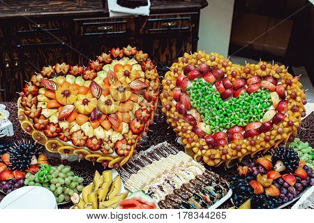 heart-shaped frame made of fruit. Wedding table