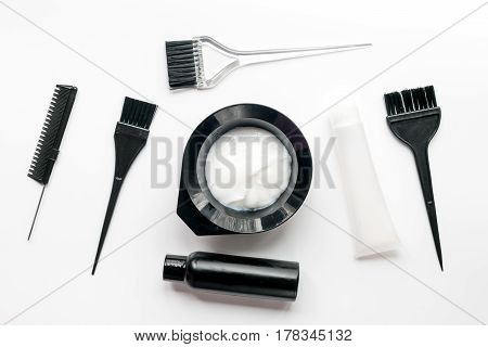 barbershop concept with hairdye tools on white table background top view