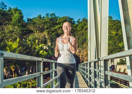 Beautiful Woman Running Over Bridge During Sunset
