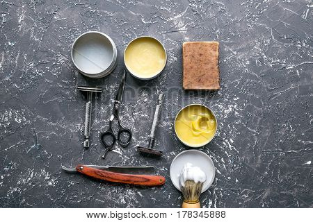 barbershop for men with tools for shaving on gray table background top view mock up