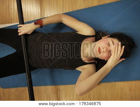Teenager Girl Lay On Gym Rag With Bar Tired Closed Eyes