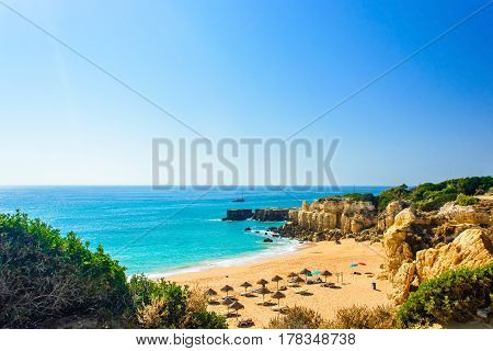 beautiful sea view of sandy beach Pria do Castelo in Algarve region Portugal