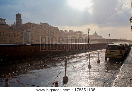Florence City In Italy In The Rain. Beautiful Sky And Sun