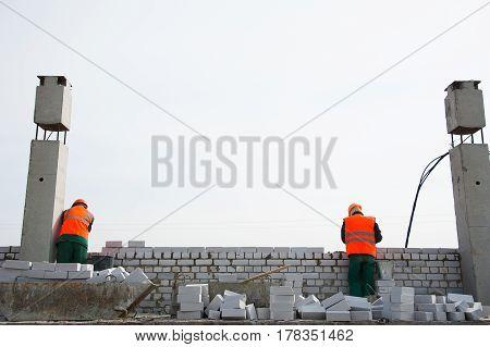 Construction Mason Making A Brickwork