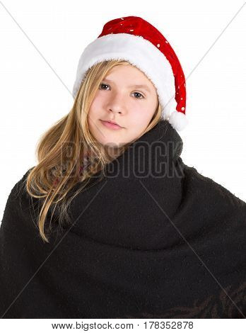 Young girl with cape and red winter cap standing posing isolated on white background
