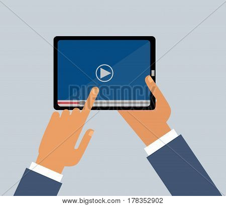 Men Hands holds  tablet screen . Video player application on your tablet  screen. Video.