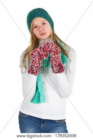 Young girl with white shirt beanie and wooly gloves eating gingerbread isolated on white background