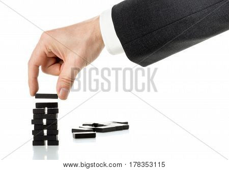 Business man building domino tower - kick-off milestone or progress concept
