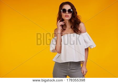 beautiful sexy young woman  ideal for advertising as a magazine cover yellow background