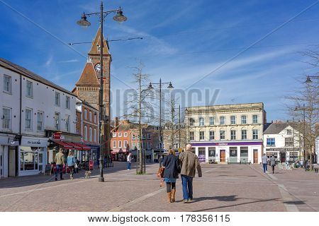 Newbury, UK. 26th March 2017. Market Square in central Newbury on a sunny spring day with people walking the streets.