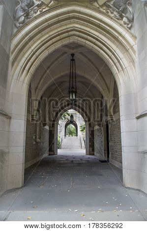 Series of gothic arches with stairs and hanging lights