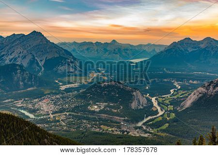 Banff, Alberta, Canada - Aerial view of Banff Town and the Canadian Rockies under golden sunset.