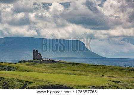 Classiebawn Castle sitting on a green hill overlooking Mullaghmore Village in County Sligo, Ireland