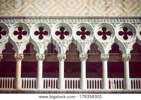 Architectural details of Doge`s Palace in Venice (Italy). Edited as a vintage photo with dark edges.