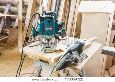 Tools In The Carpentry Workshop: Electric Milling Cutter, Grinder.