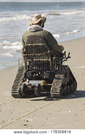 A Track powered wheele chair propels a person along the sands of Myrtle Beach South Carolina