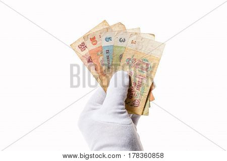 Several old Soviet banknotes of various denominations clamped in the hand
