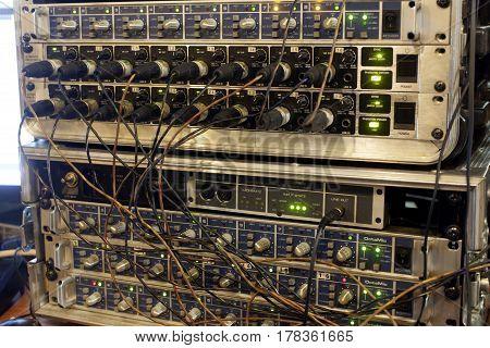 Sound Studio Adjusting Record Equipment.