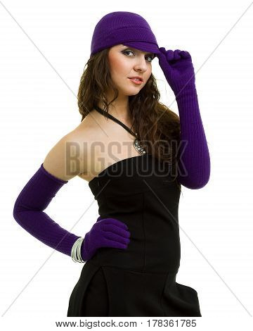 knitwear. young woman wearing a winter cap and gloves, isolated on white background