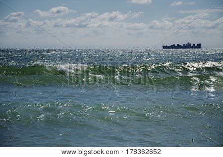 The view of the Black Sea from the shore the waves and the sun's reflection from the water