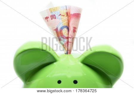 Green piggy bank with China currency RMB