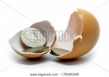 Cracked Egg Shell And Coins