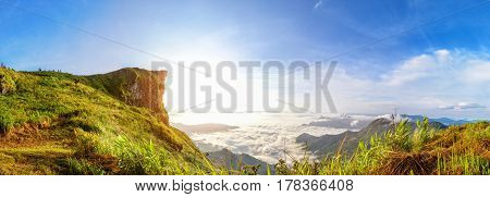Panorama beautiful landscape nature of sunrise on peak mountain with sun cloud fog and bright colors of sky in winter at Phu Chi Fa Forest Park is a famous tourist attraction of Chiang Rai Province Thailand