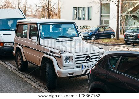 STRASBOURG FRANCE - FEB 13 2017: Front of luxury white Mercedes-Benz G-Class suv parked on French street.