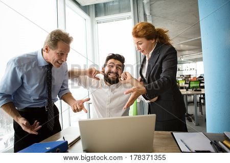 Angry bosses man and woman screaming, shouting and yelling at their worker. Handsome man having stress and closing with ears. Mobbing, stress, work, scandal concepts.
