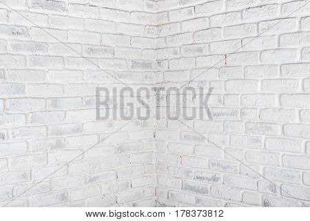 Abstract horizontal white background. Angle of a frayed brick wall.