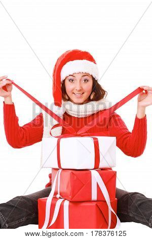 Beautiful girl in santa hat with gift christmas decorated background.