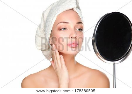 Portrait of beautiful girl touching her face with a towel on head