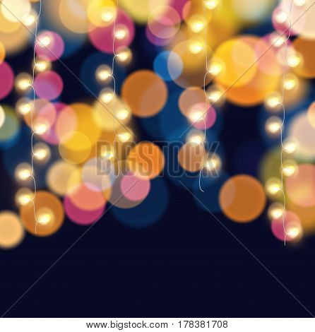 Hanging fairy lights on colorful light bokeh background