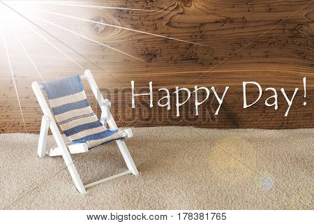 Sunny Summer Greeting Card With Sand And Aged Wooden Background. English Text Happy Day. Deck Chair For Holiday Or Vacation Feeling.