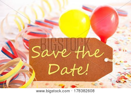 One Label With English Text Save The Date. Party Decorations, Streamers, Confetti And Balloons. Wooden Background With Vintage, Retro Or Rustic Syle