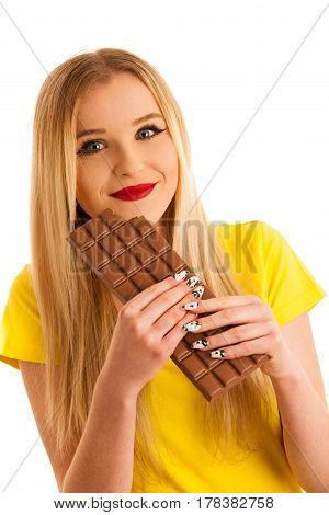 Undecided Woman Holding Scale And Chocolate Uncertain Wether To Loose Weight Isolated Over White Bac