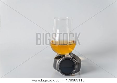 Delicious Single Malt Whiskey Glass With Smartwatch On A White Background,