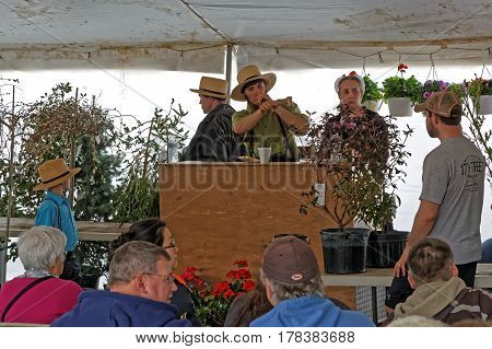 GAP PENNSYLVANIA - MARCH 25 2017: Amish volunteers sell potted plants under a tent at the annual