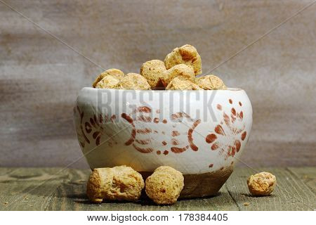 Uncooked soy Nuggets in a container selective focus.
