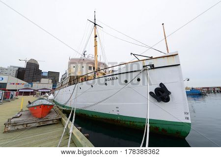 HALIFAX, NS, CANADA - MAY 22, 2016: CSS Acadia is a former oceanographic research ship. She served for Canada from 1913 to 1969 and permanently docks at Halifax Harbour as part of Maritime Museum of the Atlantic in downtown Halifax, Nova Scotia, Canada.