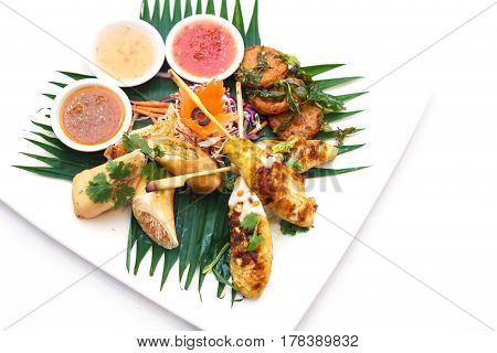 Chicken Satay And Fried Fish-paste Balls And Spring Rolls