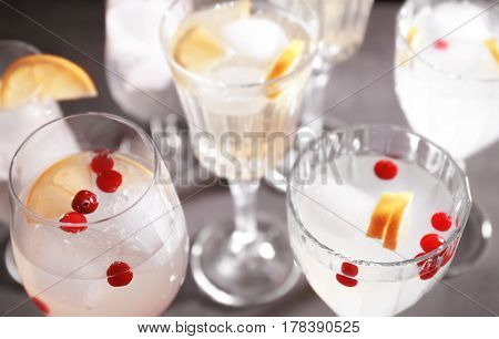 Different refreshing cocktails on table