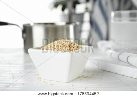 Bowl with quinoa seeds on kitchen table