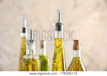 Composition of bottles with oil on blurred background