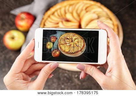 Blogger making photo of homemade apple pie, closeup