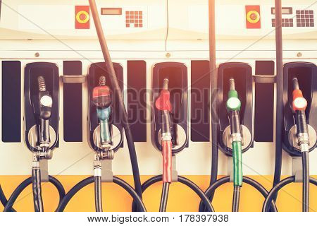 Gasoline nozzle in petrol station service, vintage color tone.