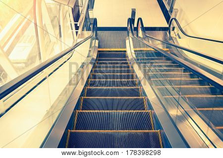 Escalator step and window inside building, vintage color tone.